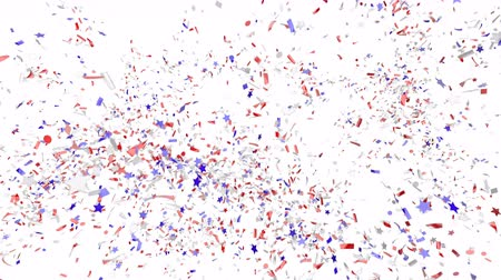 Blue, red and white festive confetti explosion falling down on a white background. Animation with alpha channel. Stock mozgókép
