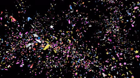 Triple explosion of multi-colored confetti falling on a black and green background. Festive 3d animation
