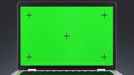 szablon : Laptop computer with a green screen on a gray background. 4K animation is perfect for placing your images or videos.