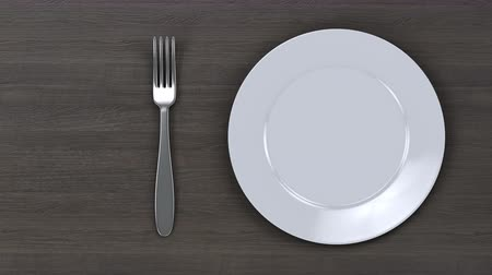 Empty plate. Move a white plate with a knife and fork on a wooden table background. Alpha animation for easy editing