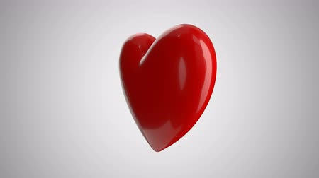 Animation rotation of a big red heart on a light background. Valentines Day Stock mozgókép