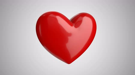 Animation of a big red heart pulsating on a light background. Valentines Day
