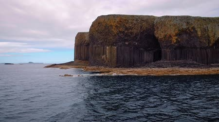 Sailing in the Scottish Hebrides, close to dramatic Fingals Cave on Staffa Island, famous for its breathtaking basalt columns. Handheld stabilized shot in high frame rate.
