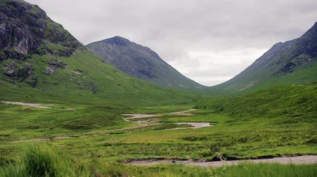 Glen Coe valley in the Highlands of Scotland. Typical overcast skies on a summer day in Glen Etive. Several birds flying around. Steady shot in high frame rate with a little speed-up in the end.