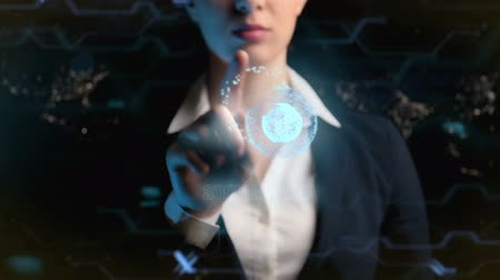 Social media logo. Futuristic business woman, uses a hologram of the world ball. 動画素材