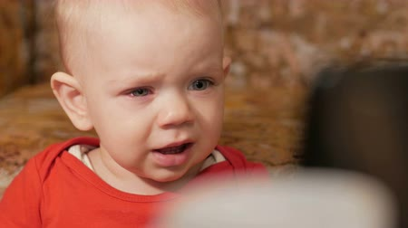 newborn child : A beautiful baby with allergies. Red swollen eyes. The boy was crying and struggling with the disease. Kid 1 year. Close-up Stock Footage