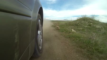 buggy car : High speed driving with luxury car on a bad road and dust coming out from wheels