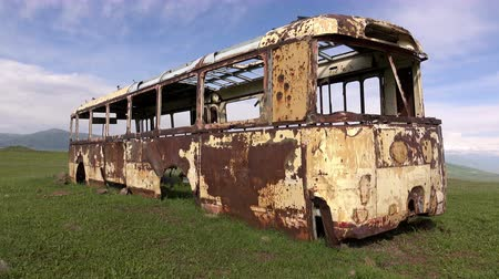 wrecker : Dolly shot of the rusted auto bus