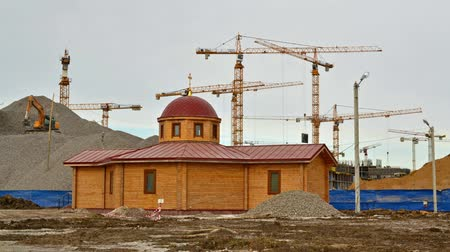 timeline : construction of residential quarters on the background of the wooden church