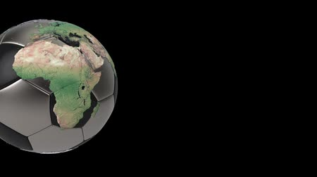 atlasz : Realistic soccer ball isolated on black screen. 3d seamless looping animation. Detailed world map on black and iron soccer ball. Concept football earth globe. Sport design element. Stock mozgókép