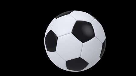 league : Realistic black and white soccer ball isolated on black background. 3d looping animation. Football design element. Stock Footage