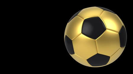 futball labda : Realistic black and gold soccer ball isolated on black background. 3d looping animation. Football design element. Stock mozgókép