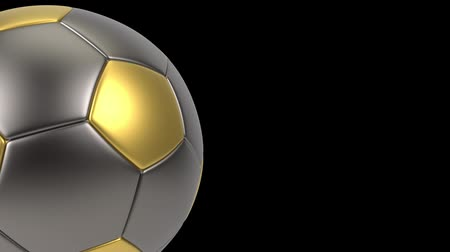 pontão : Realistic gold and iron soccer ball isolated on black background. 3d looping animation. Football design element. Stock Footage