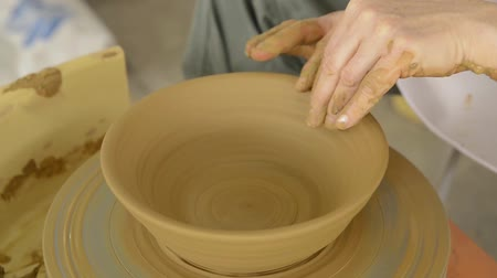 terrakotta : hands are shaping clay