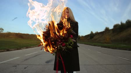 garip : Girl with a bouquet in flames of fire