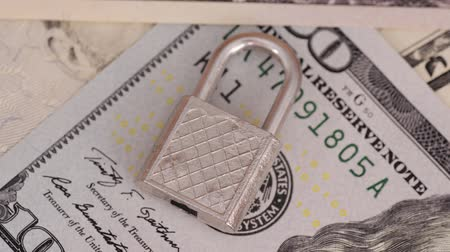 cem : Padlock on United States one hundred-dollar bill