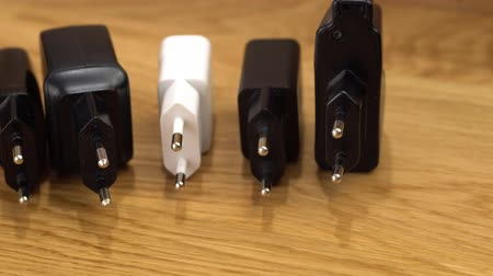 adapter : Various USB battery Charger on wooden table. Stock Footage
