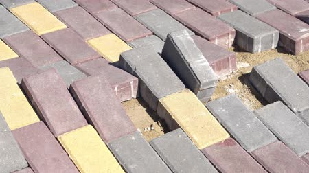 kabarık : Raised paving slabs on a footpath. Stok Video