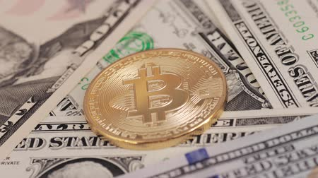 us banknotes : Golden plated bitcoin and dollar bills. Stock Footage