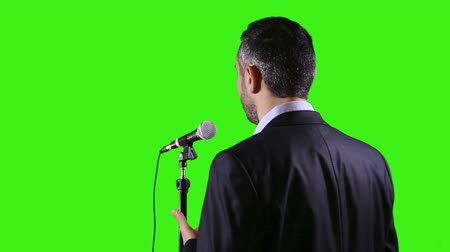 politikacı : Green screen of a man give public speech at a conference in front of live audience