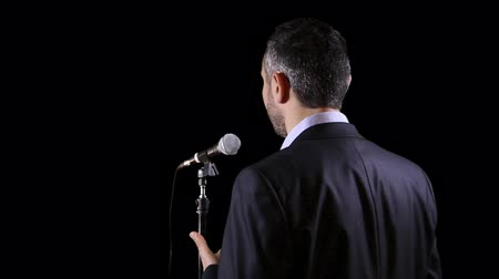 arka görünüm : man give public speech at a conference in front of live audience
