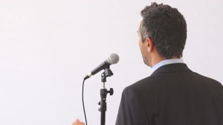 лекция : Man with microphone giving a lecture
