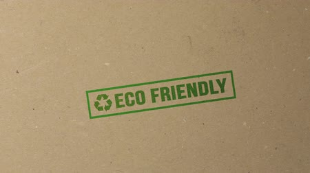 eco : Shot of Eco friendly green ink stamp on documents folder Stock Footage