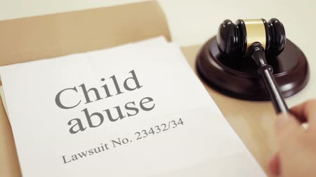 taciz : Shot of Child abuse lawsuit verdict with gavel placed on desk of judge in court