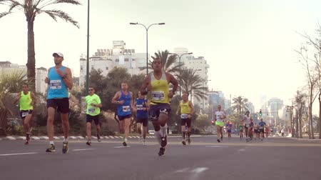 kilometer : Shot of Runners 100 fps on the Tel-Aviv Marathon Stock Footage