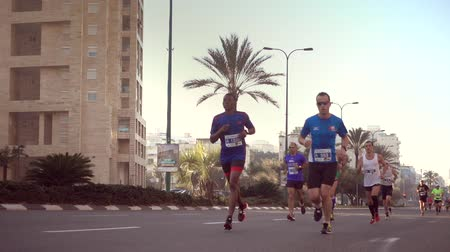 kilometer : Shot of 100 fps of men running at the Tel-Aviv Marathon