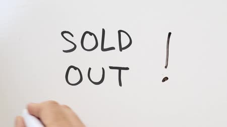 satılır : Shot of Sold Out written on whiteboard