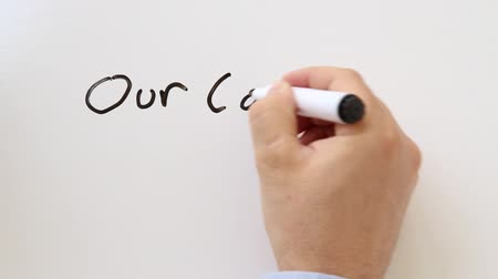 suécia : Shot of Our company whiteboard writing animation