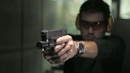shooting range : Shot of Man in range shooting a gun