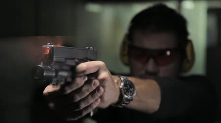 shooting range : Shot of Man shooting a gun with audio Stock Footage