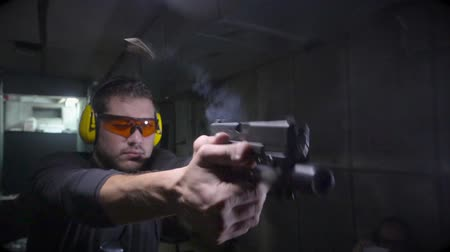 стрельба : Shot of Front side angle of shooter in slow motion