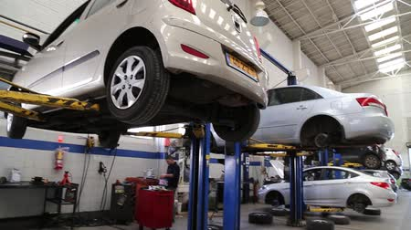 diagnostics : Shot of Cars on lift in a garage
