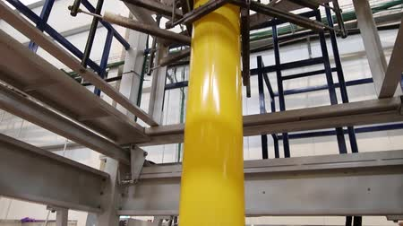 chloride : Extrusion stage of yellow plastic production line Stock Footage