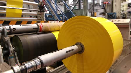roll : Plastic bags production line with yellow sheet Stock Footage