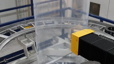 tubular : Robotic quality control unit on plastic extruder Stock Footage