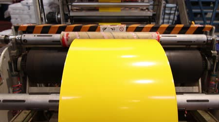 polyvinyl : Yellow plastic bags factory line Stock Footage