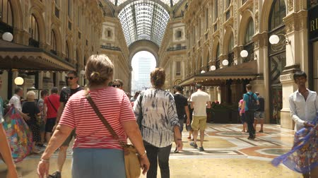 galleria vittorio emanuele ii : Visitors inside shopping mall in Milan
