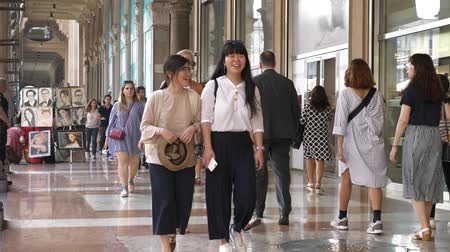 entrance : Tourists and locals buying at shopping mall in Milan