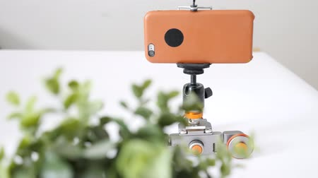 gimmick : Smartphone attached to motorized slider dolly Stock Footage
