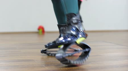 Female feet shod in special shoes jump on training in the hall. Healthy way of life. A novelty in the fitness industry.