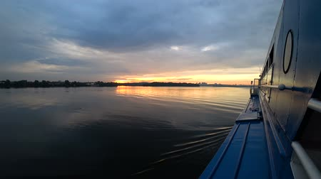 Landscape from the ship that sails on the river at sunset. Leisure and walk on water transport.