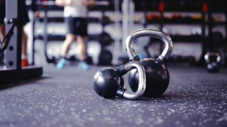 close up shot : Pair of kettlebells laid on the floor in gym