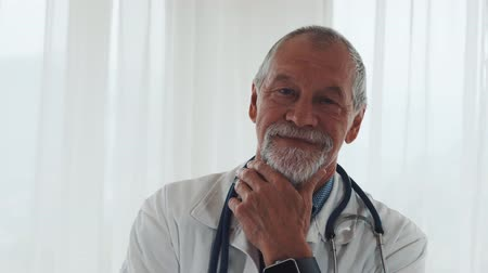 medical occupation : Portrait of a senior doctor with smartwatch in office.