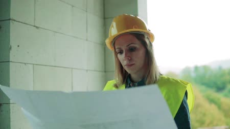 housing problems : Young woman worker on the building site.
