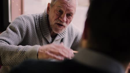 grandad : Senior father and his young son in a cafe. Stock Footage