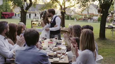 guests : Wedding reception outside in the backyard.